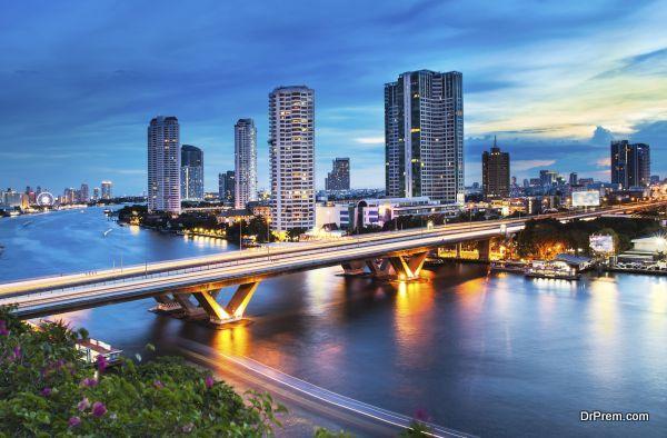Urban City Skyline, Chao Phraya River, Bangkok, Thailand.
