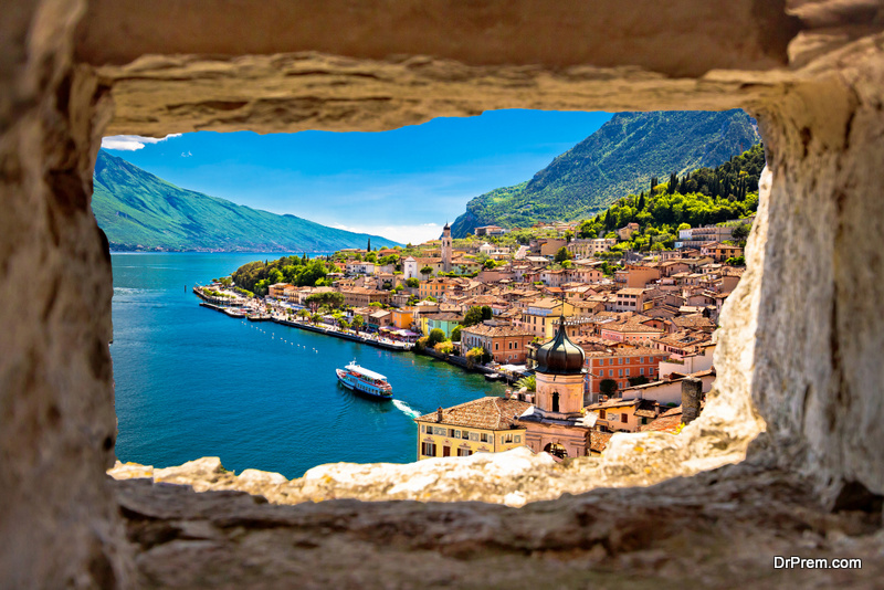 Limone sul Garda view through stone window from hill, Garda lake in Lombardy region of Italy