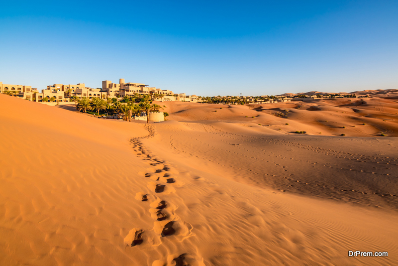 Footprints on desert sand in Abu Dhabi