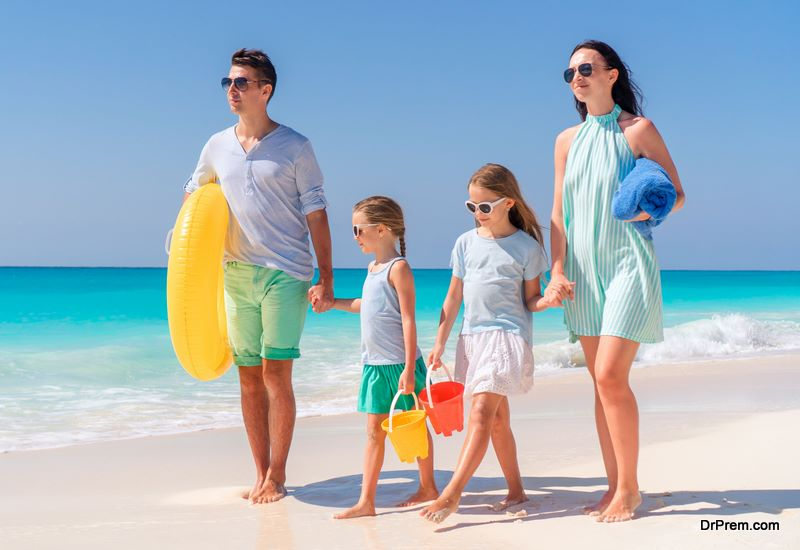 Young family on vacation have fun on the beach