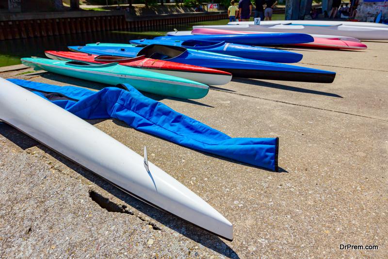 Arranged colorful kayaks on the concrete coast